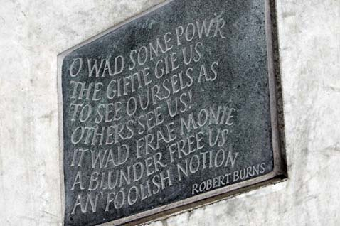 Literary quotes cut into stone panels as part of the Canongate Wall at the Scottish Parliament.
