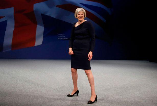 Theresa-May-strange-stance