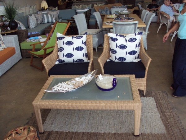 Single weaved Elita arm chairs in honey wicker