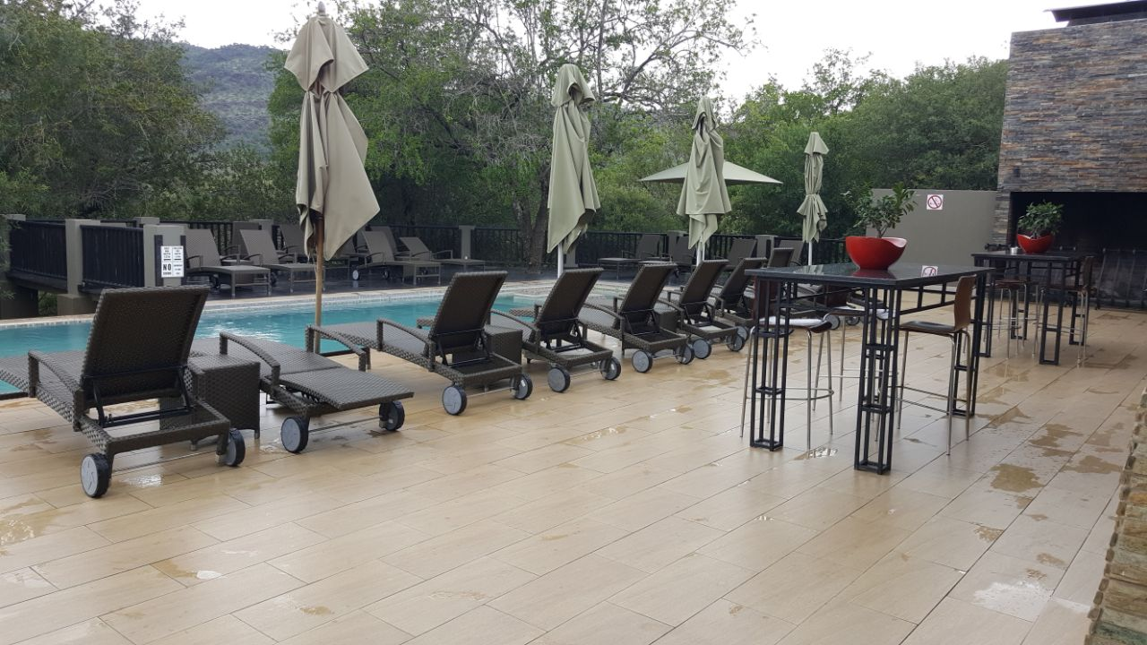 Loungers with adjustable backs and wheels.