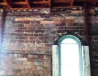 Contrast of old brick and new wood near the second floor window