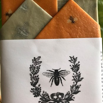 Silver bee, honey bee and honeycomb print reusable beeswax food wraps in Starter Pack featuring four wraps