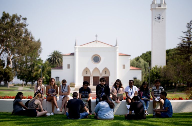 Students talking in front of the chapel