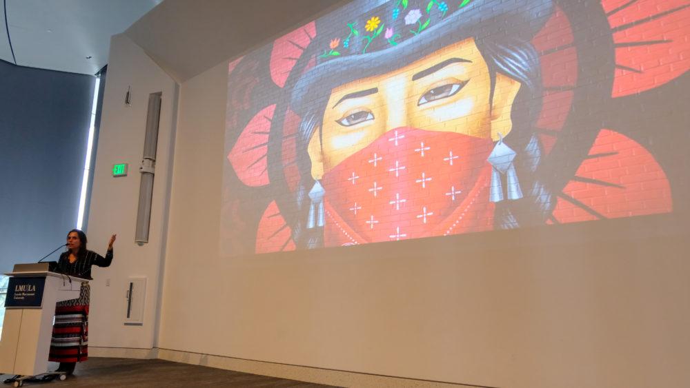 Winona LaDuke speaking with projector