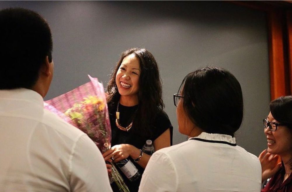 Chantel Nong, holding a bouquet of flowers.