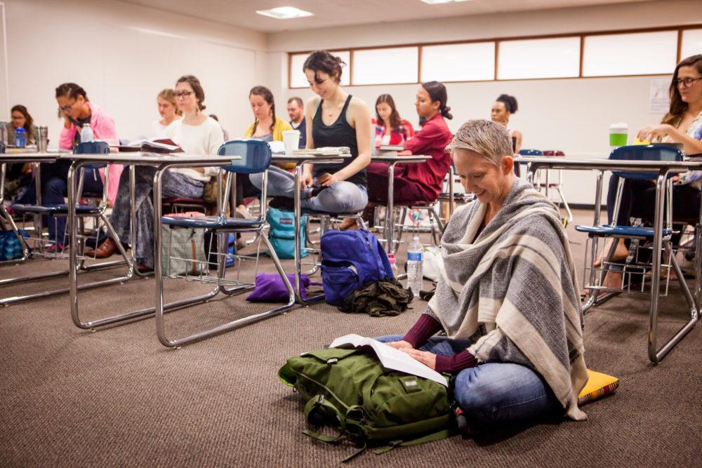Yoga Studies students doing meditative poses.