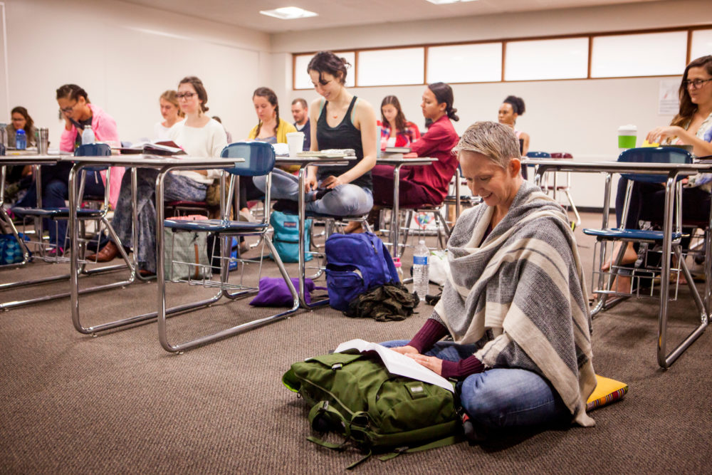 Yoga Studies students doing meditative poses.