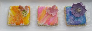 Delicious and beautiful hand painted topped with a sugar flower, a lovely spring or Easter gift and we ship!