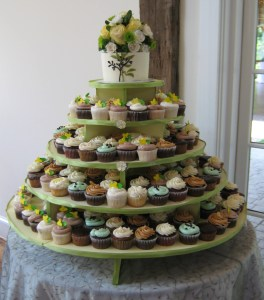 Beautiful cupcake twoers are a popular way to serve many flavors in serving size cakes! Decorated or colored to your specifications!