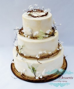 Lovely woodland cake is designed for a nature themed wedding