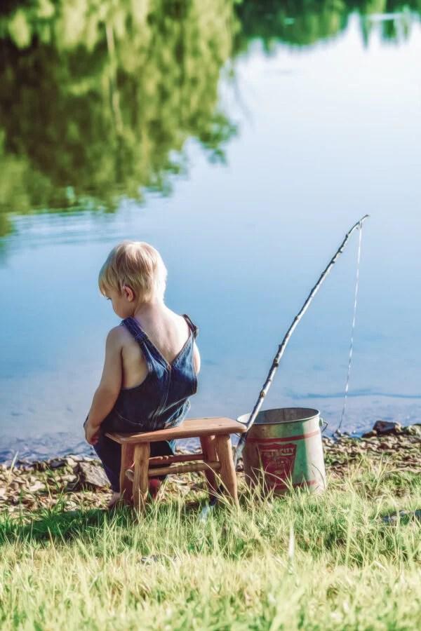 little boy go fishing in summer southeast missouri