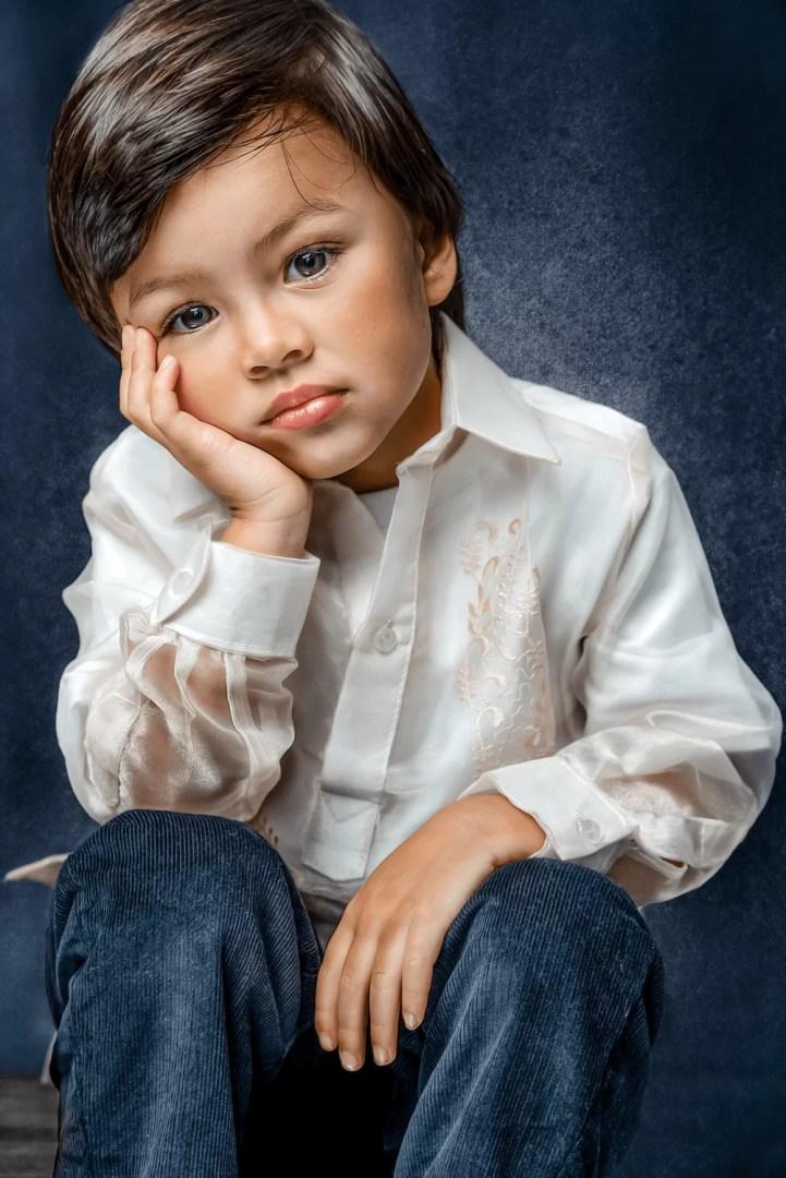 children portrait of filipino boy thinking