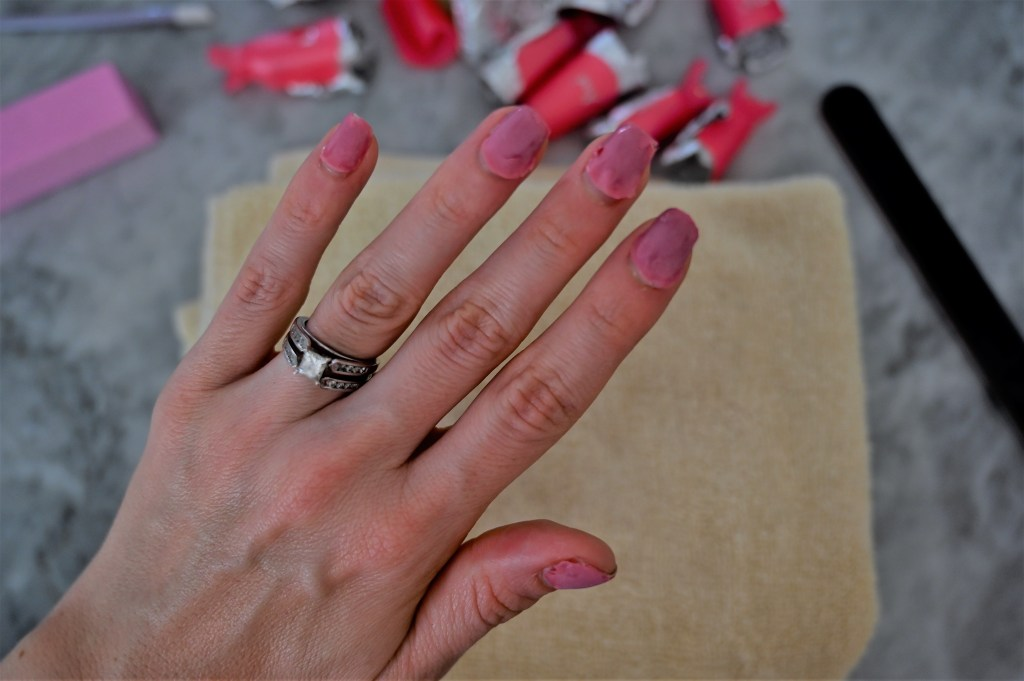 Lifestyle blogger Maria Munoz removing gel nails flaking off