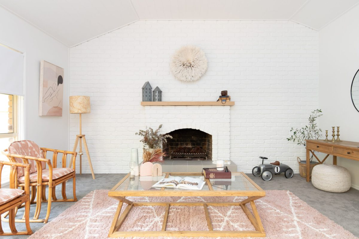 Front fireplace white brick modern living space pink rug wicker copy