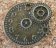 Horloge avec engrenages (gears), bronze foncé, diamètre d'environ 20-22mm