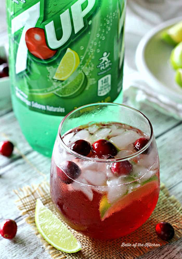 This Cranberry Limeade Spritzer is the perfect festive drink for any holiday party! Made with freshly squeezed limes, cranberry juice, and refreshing 7UP®, your guests will love sipping on this bubbly treat!