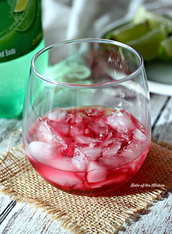 This Cranberry Limeade Punch made with 7UP is the perfect festive drink for any holiday party! Your guests are sure to love sipping on this bubbly treat.