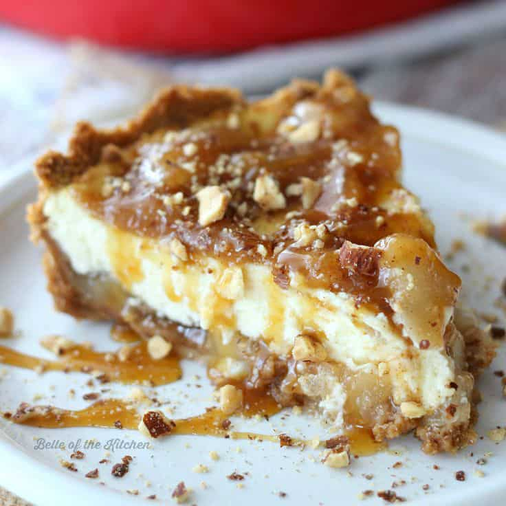 Homemade Caramel Apple Cheesecake on a graham cracker crust, filled with sweet, juicy apples and creamy caramel. It's the perfect finish to any fall meal!
