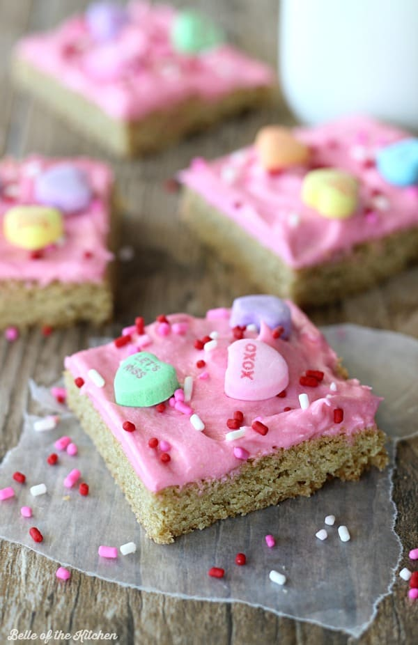 These Sugar Cookie Bars are so yummy and much easier to make than traditional sugar cookies! The dough is baked on one large cookie sheet, then topped with a homemade vanilla frosting.