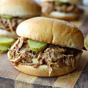 These BBQ Root Beer Chicken Sandwiches are made in the slow cooker and come together with just five simple ingredients! They are full of flavor and make a perfect summer time dinner!