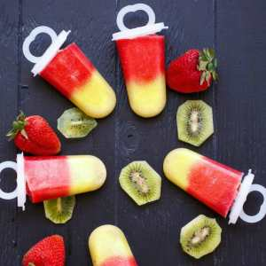 These three-ingredient strawberry kiwi popsicles are super easy to make and a fun project to do with the kids this summer!