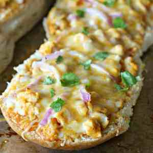 Buffalo Chicken French Bread Pizza -this is SO good and SO easy! Ready in under 15 minutes!