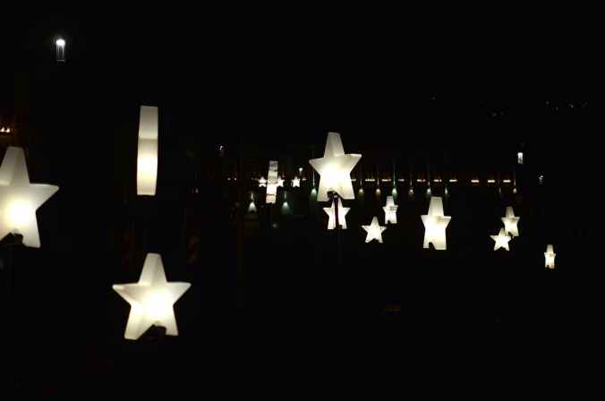 shiny star shaped decoration illuminating dark street