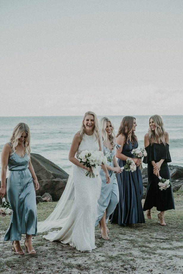 "Seaside Bridal Photo Photo - Lucas & Co Photography ""width ="" 615 ""height ="" 923 ""data-pin-description ="" Blue mismatched bridesmaid dresses   Beach Wedding Ideas With A Touch Of Glamor   Seaside Bridal Photo Photo - Lucas & Co Photography #bridesmaids #bridesmaiddress #bridesmaidsdresses #dress #bridalparty #bridesmaid #bridesmaiddresses ""data-pin-id ="" 21673641944124145 ""srcset ="" https://bellethemagazine.com/wp-content/uploads/ 2017/10 / Seaside Bridal Photo Party 3-e1512174472109-615x923.jpg 615w, https://bellethemagazine.com/wp-content/uploads/2017/10/Seaside-Bridal-Party-Photo-3-e1512174472109 -300x450.jpg 300w, https://bellethemagazine.com/wp-content/uploads/2017/10/Seaside-Bridal-Party-Photo-3-e1512174472109-768x1152.jpg 768w, https://bellethemagazine.com/wp -content / uploads / 2017/10 / Seaside-Bridal-Party-Photo-3-e1512174472109.jpg 900w ""sizes ="" (max-width: 615px) 100vw, 615px ""data-jpibfi-post-excerpt ="" ""data"" jpibfi-post-url = ""https://bellethemagazine.com/2019/06/beach-wedding-ideas-glamour-tropic-coastal.html"" data-jpibfi-post-title = ""Beach Wedding Ideas That'll Add Glamor to Your Tropical or Coastal Affair ""/></a data-recalc-dims="