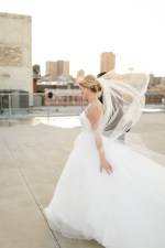 Simple ballroom wedding dress with tulle veil - Photography: Rochelle Louise