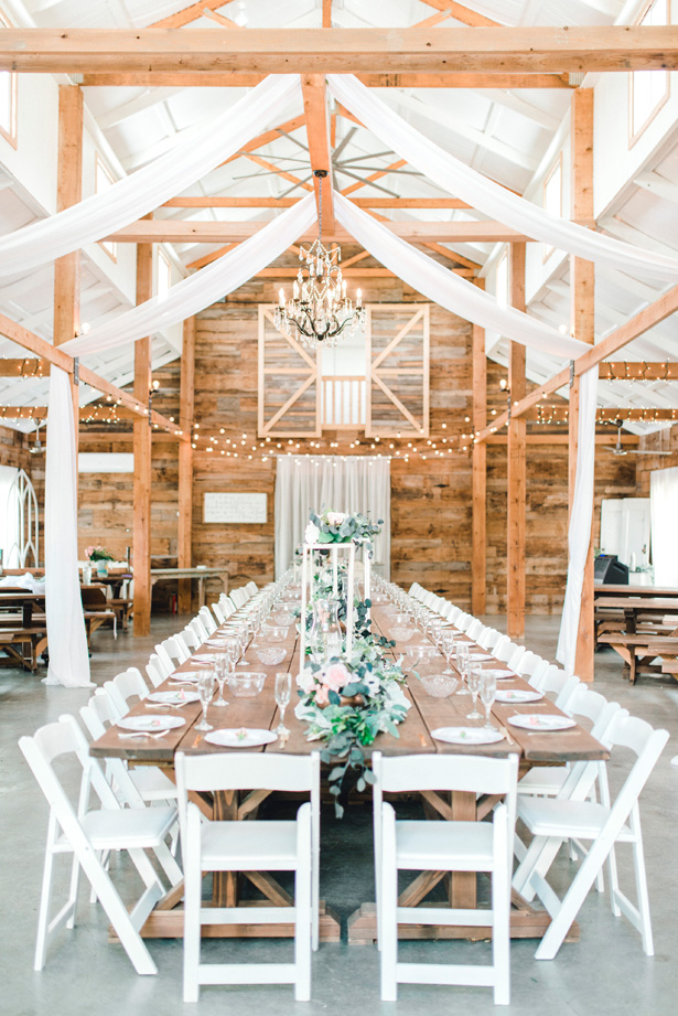 Long wedding tablescape at a rustic reception - Bobbye Jean Photography