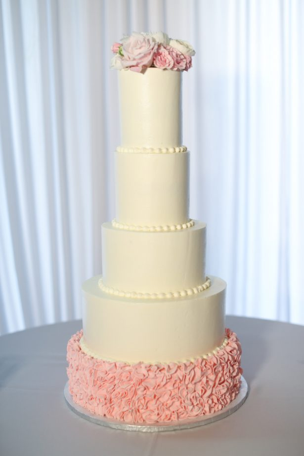 Tall white wedding cake with pink details - Krystle Akin Photography