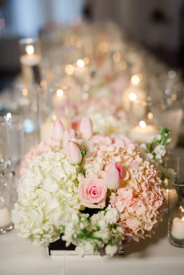 Low wedding centerpiece with candlelight for long table - Krystle Akin Photography