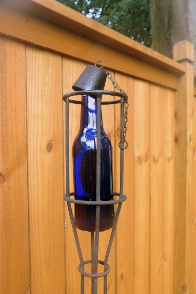 DIY - Bottle Tiki Torches - Beer bottle in stand (iron top)