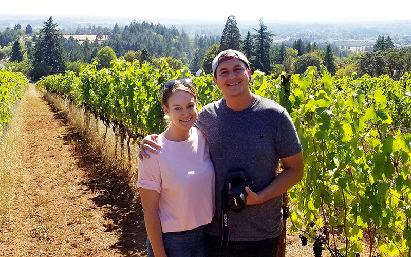 Couple standing in a vineyard