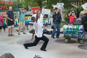 Local performer Toby Thomas, known as Mr. Awesome, improvises a dance at the protest. - Amelia Diehl