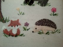 fox and hedgehog among the flowers
