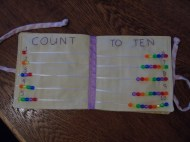 """3-4) """"count to ten"""" with beads strung on thin ribbon to visually count each number by sliding the beads along the ribbon"""