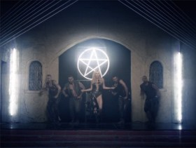 This snapshot from the music video 'Die Young' by pop singer Kesha is a good example of how symbols of light are demonized. The symbol hangs in an old church where Kesha engages in perverse acts.