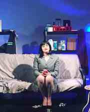 Laura Ullman as The Suit in The Women's Theatre Festival production of WATERS RISE.