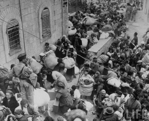 Jewish people attempting to leave portion of city surrendered to Arab forces. Jerusalem, Israel. June 1948. John Phillips