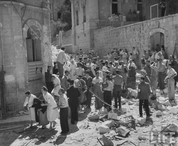 International Red Cross employees helping Jewish refugees. Jerusalem, Israel. June 1948.  John Phillips