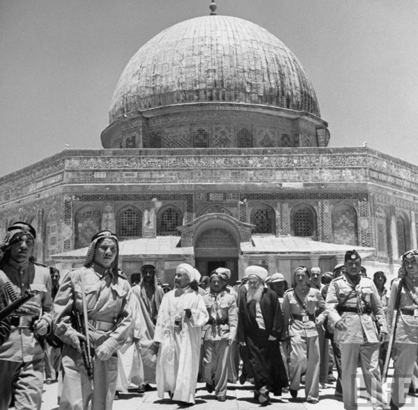 King Abdullah (fore CL) and his party standing in front of the Dome of the Rock. Jerusalem, Israel. John Phillips