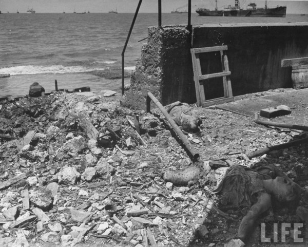 Bodies of dead Jews lie in the rubble along Tel Aviv waterfront after Arab raid. May 1948. Frank Scherschel