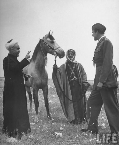 King Abdullah Ibn Hussein (L) talking to an officer. April 1948. John Phillips