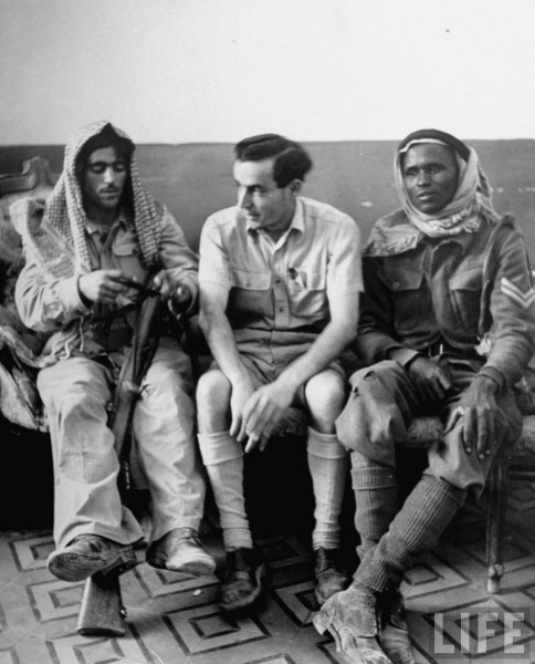 Captured Jewish soldier sitting between two members of the Arab Legion. Jerusalem, Israel. June 1948. John Phillips