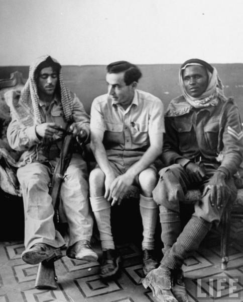 Captured Jewish soldier sitting between two members of the Arab Legion. Jerusalem, Israel. June 1948. John Phillips