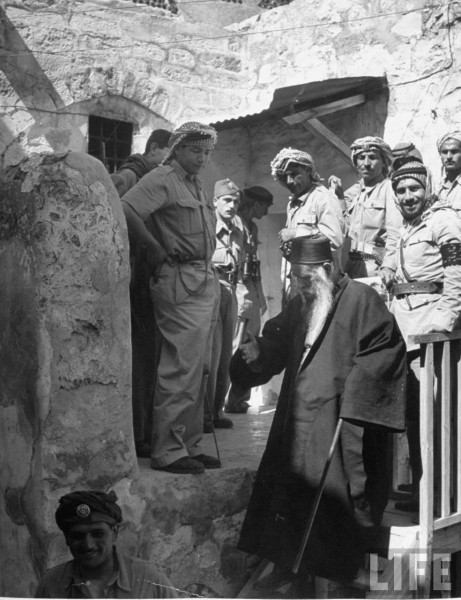 Sephardic Rabbi bringing terms of surrender of the Jewish quarter in Jerusalem to Jordanian Soldiers. June 1948. John Phillips