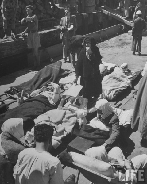 Injured Arab soldiers lying on cots wayting to be evacuated in Haifa
