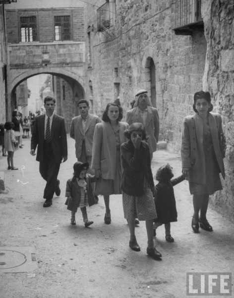 Christian family going to Church of the Holy Sepulchre in Jerusalem