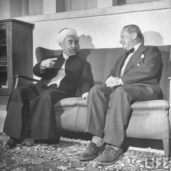 King Abdullah Ibn Hussein (L) talking with Sir Harry Luke